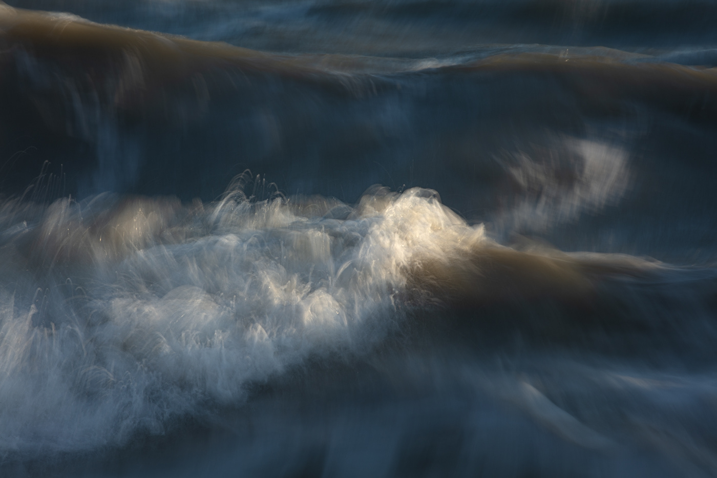 A painterly photograph of a wave