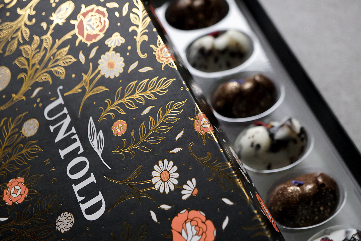 chocolate packaging,chocolates,design,desserts,gold foil,gourmet desserts,linework,packaging design