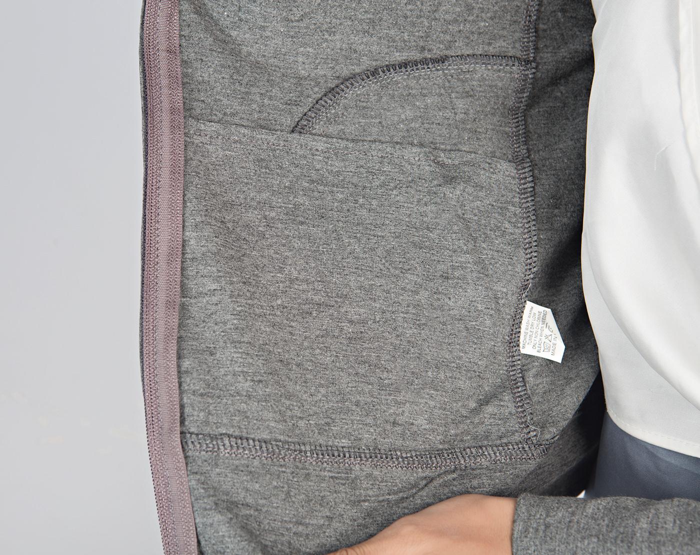Image may contain: person, pocket and bag