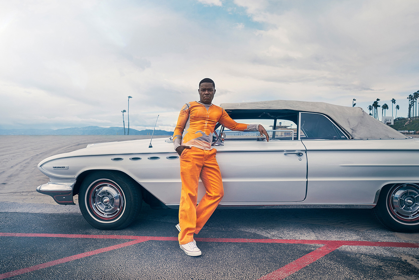 Hollywood actor David Oyelowo in front of a vintage car photographed for Alexa Magazine.