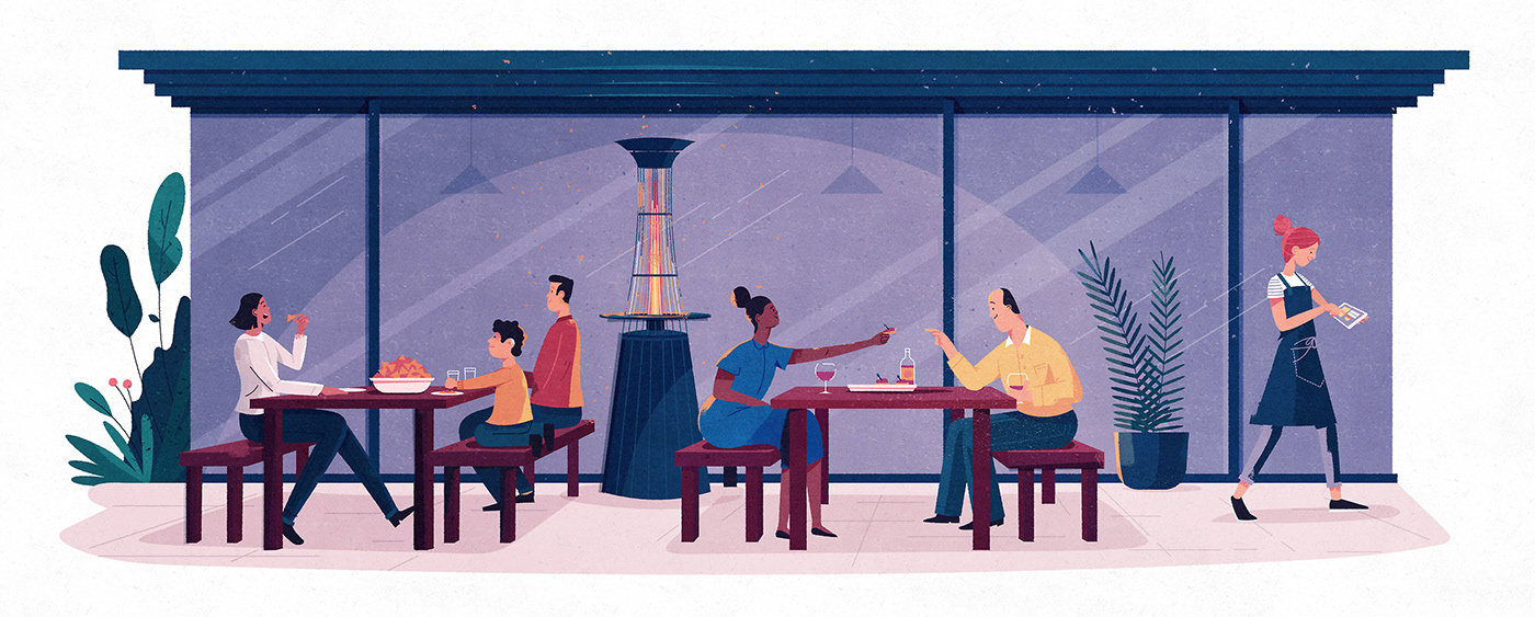 Groups of people eating casually at an outdoor restaurant