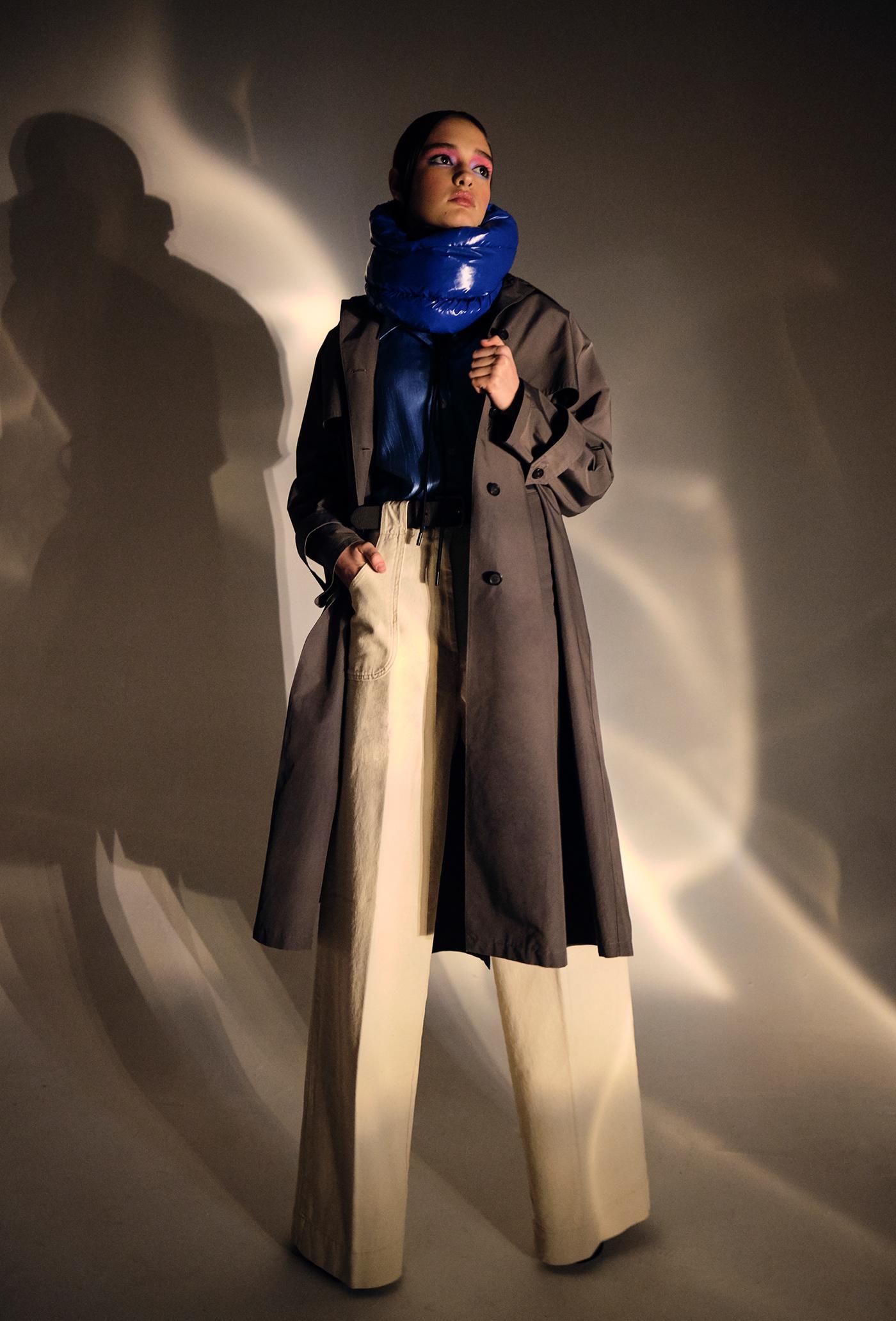 Image may contain: coat, dress and wall
