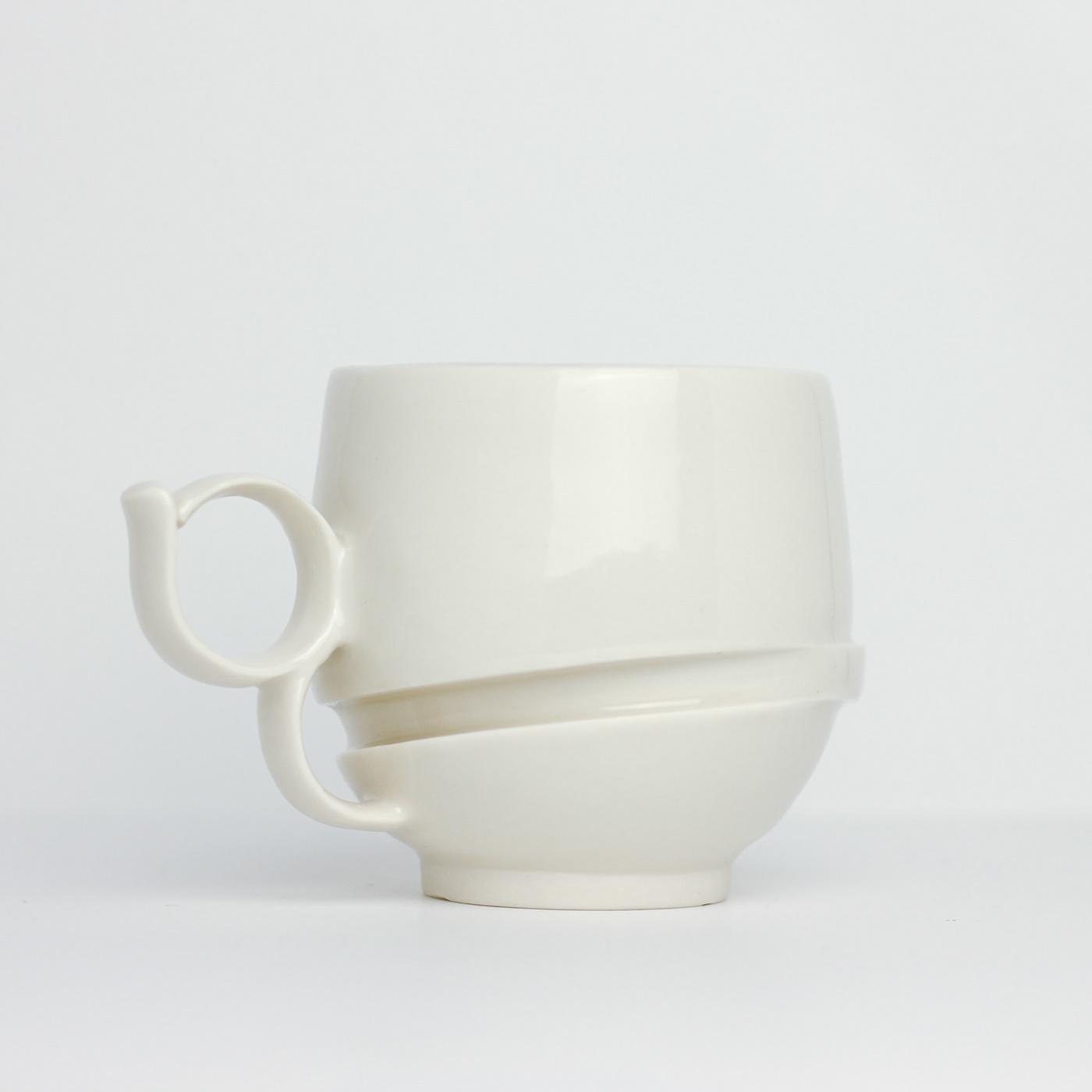 Image may contain: vase, wall and mug