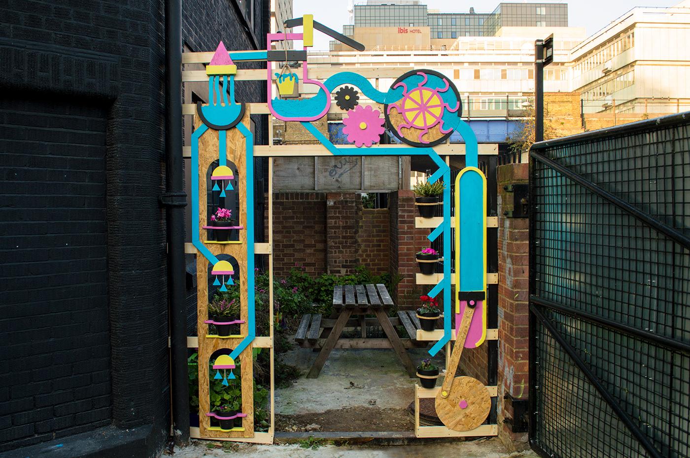 wood sculpture archway garden colour paint water machine water machine
