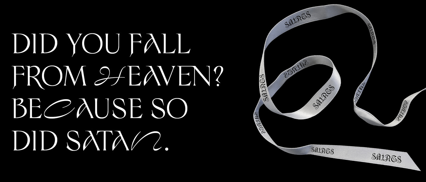 """phrase """"Did you fall from heaven? Because so did Satan"""" next to a ribbon with the logo SAINTS on it."""