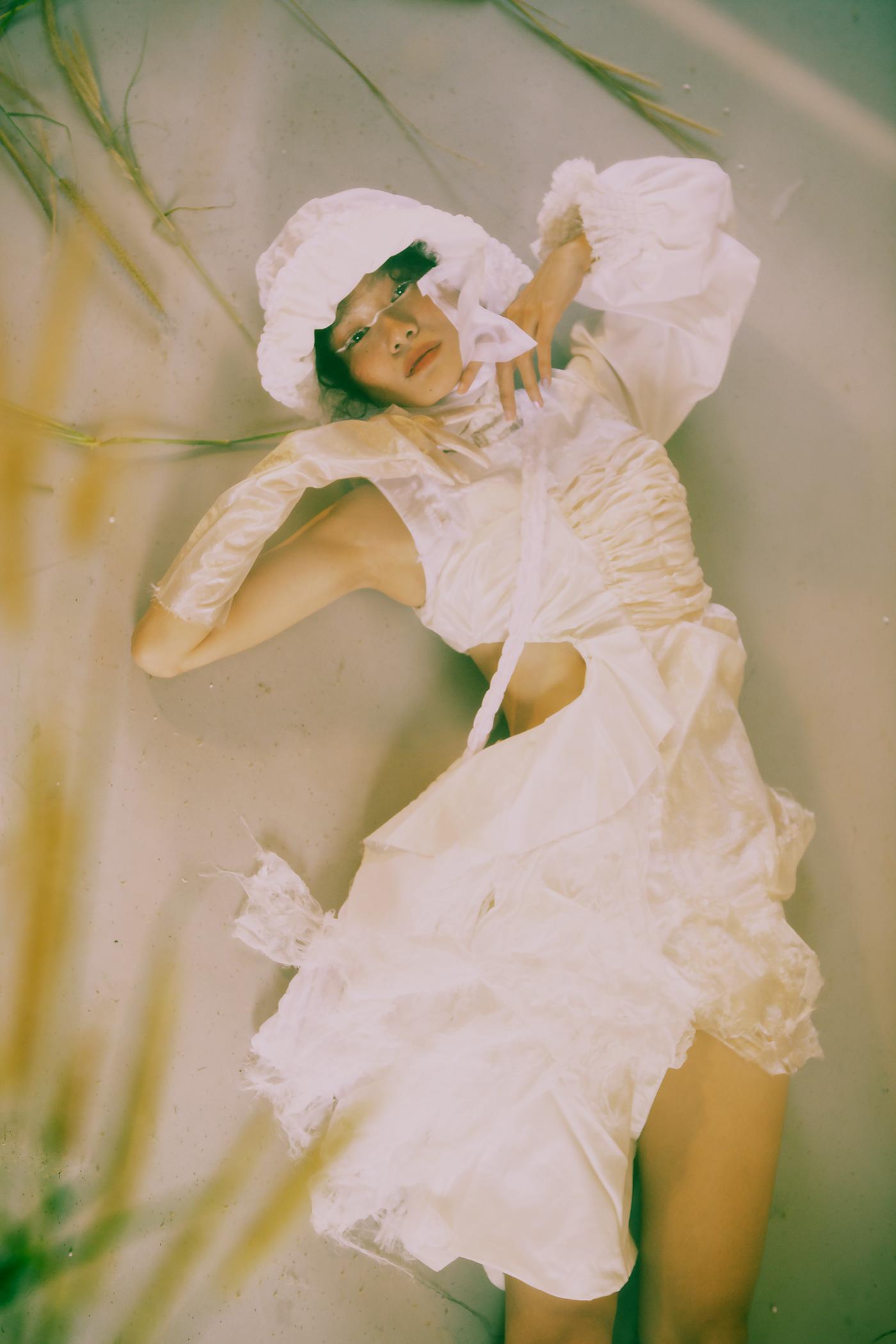 Image may contain: wedding dress and human face