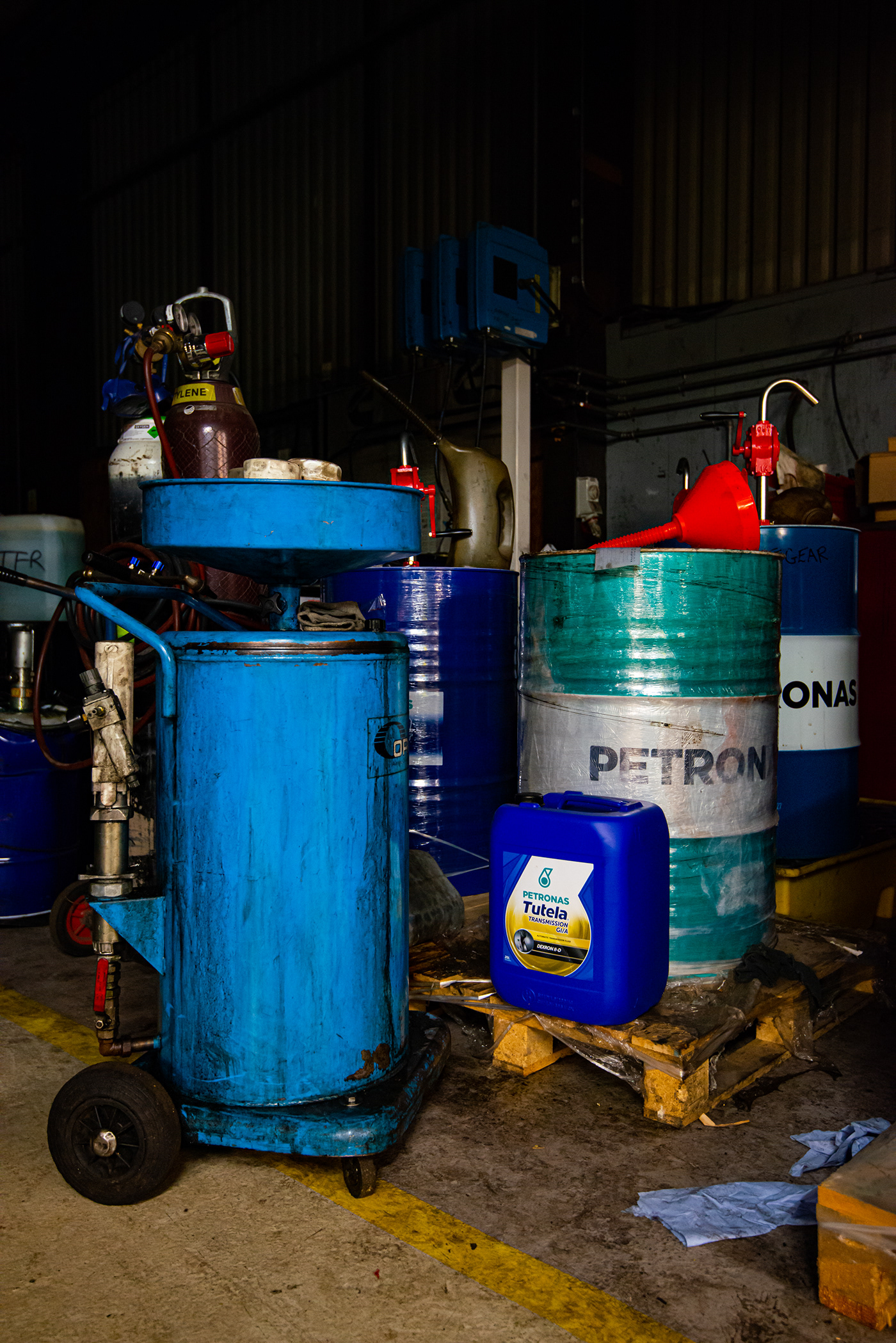 Image may contain: waste container, blue and cylinder