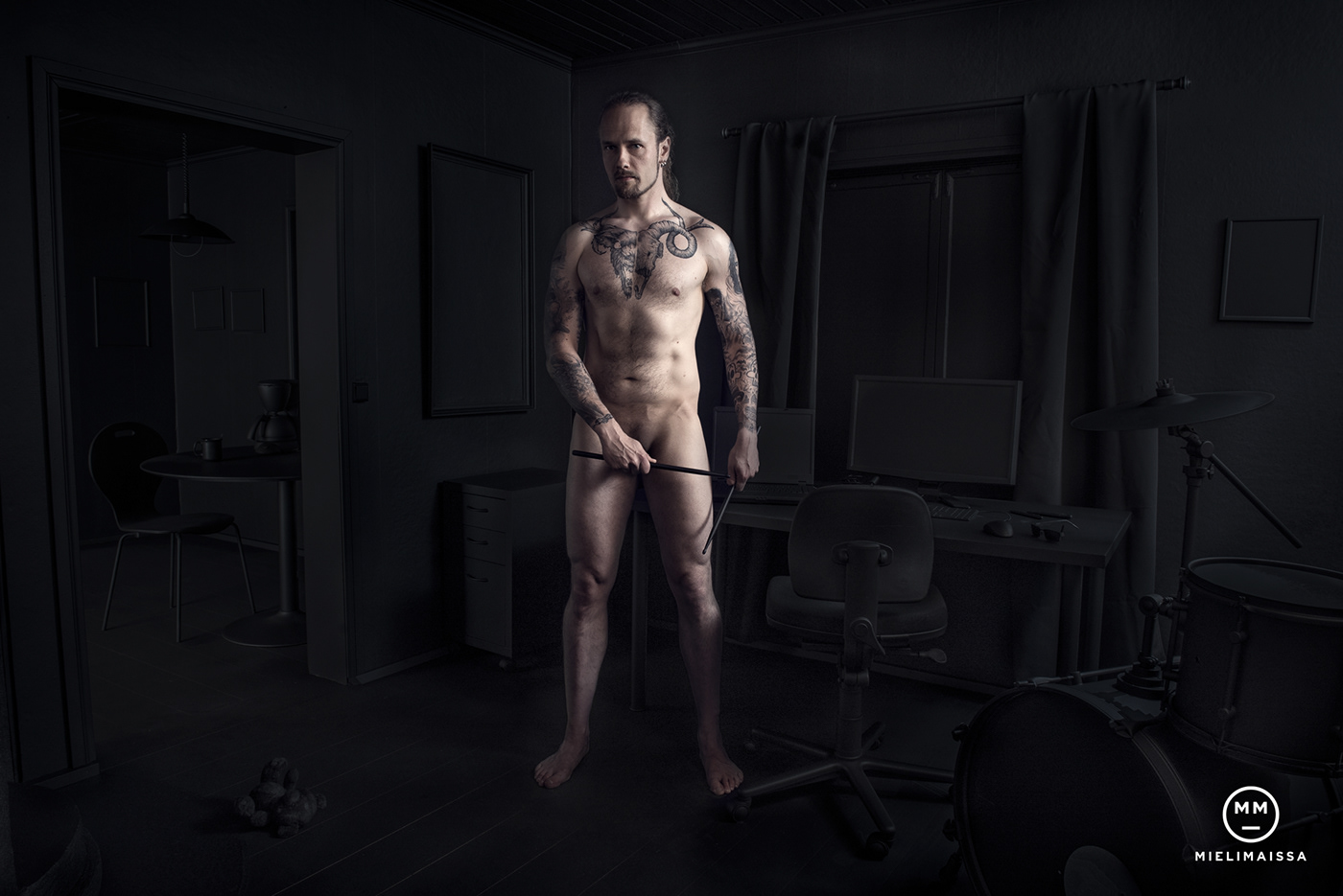 Image may contain: person, wall and man