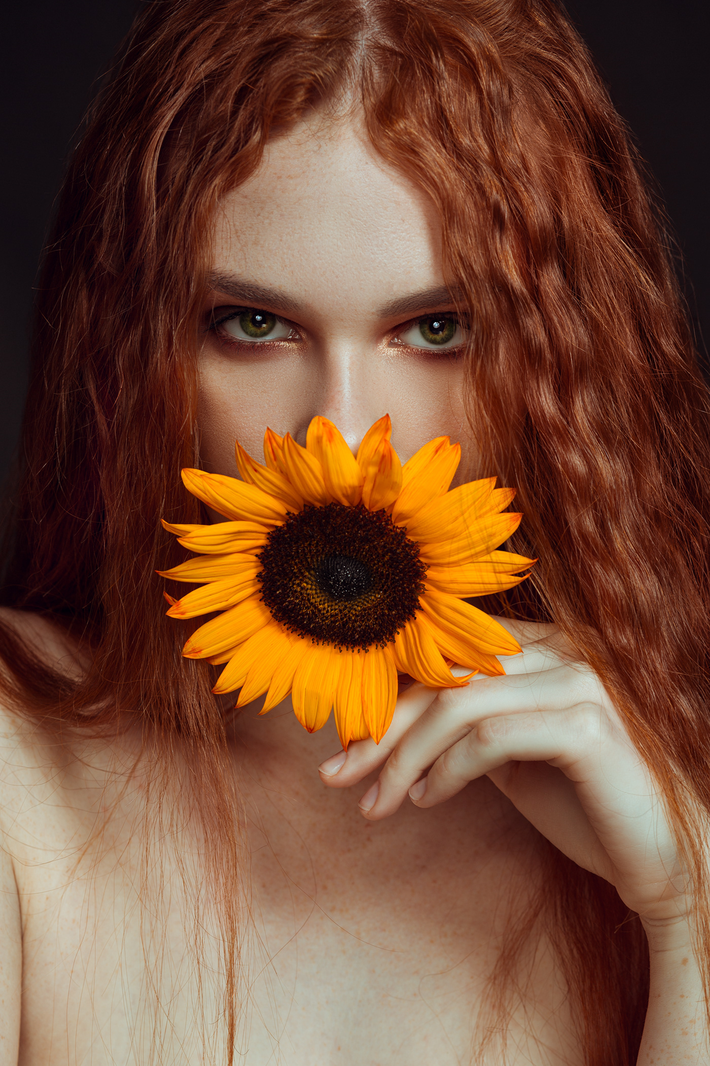 Image may contain: person, flower and sunflower