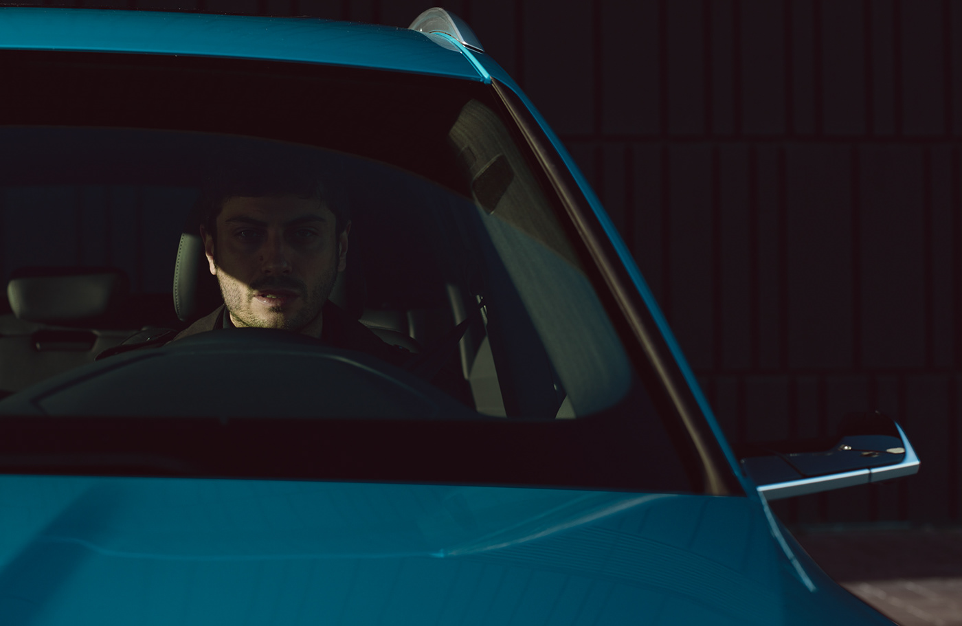Image may contain: car, vehicle and human face