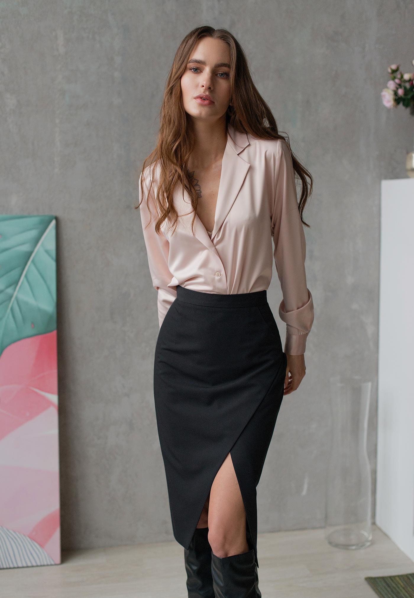 Image may contain: wall, skirt and dress