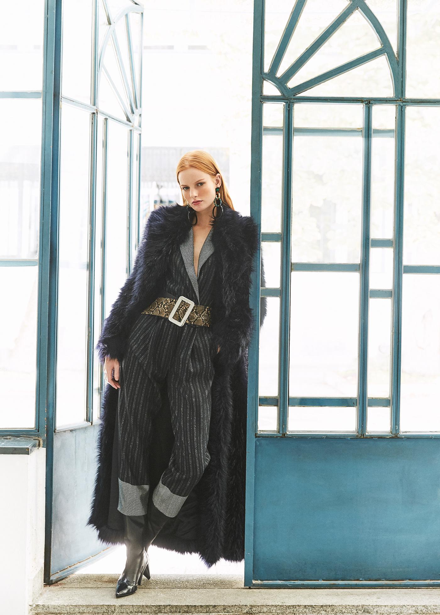 Image may contain: coat, jacket and clothing