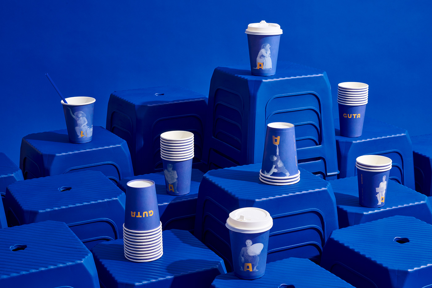 Guta Cafe, Cup Design by M — N Associates