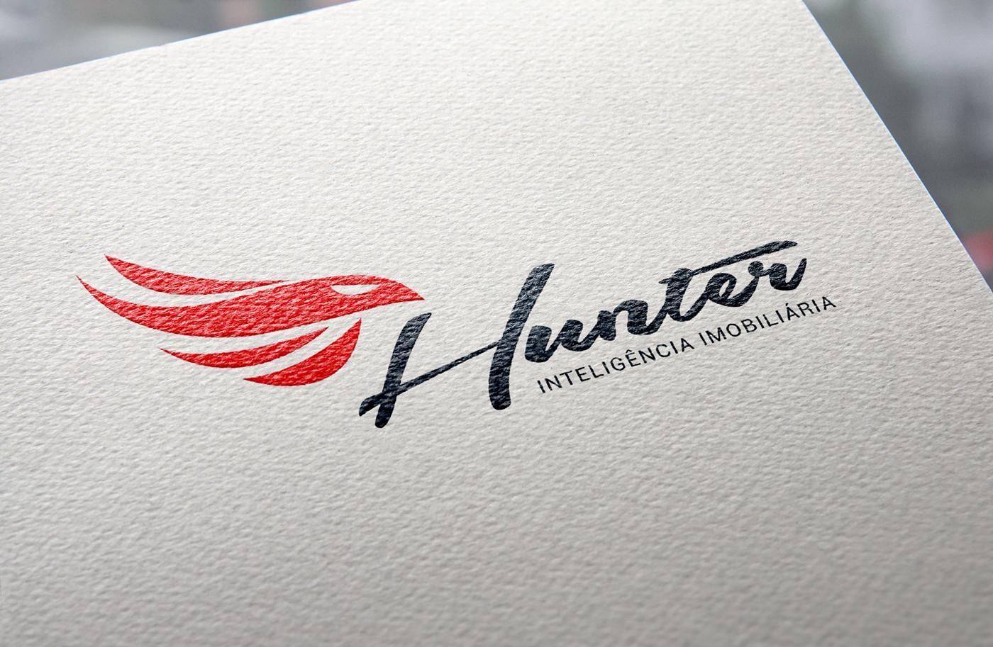 hunter imobiliária aguia Procura  imóveis diferencial realestate logo brand