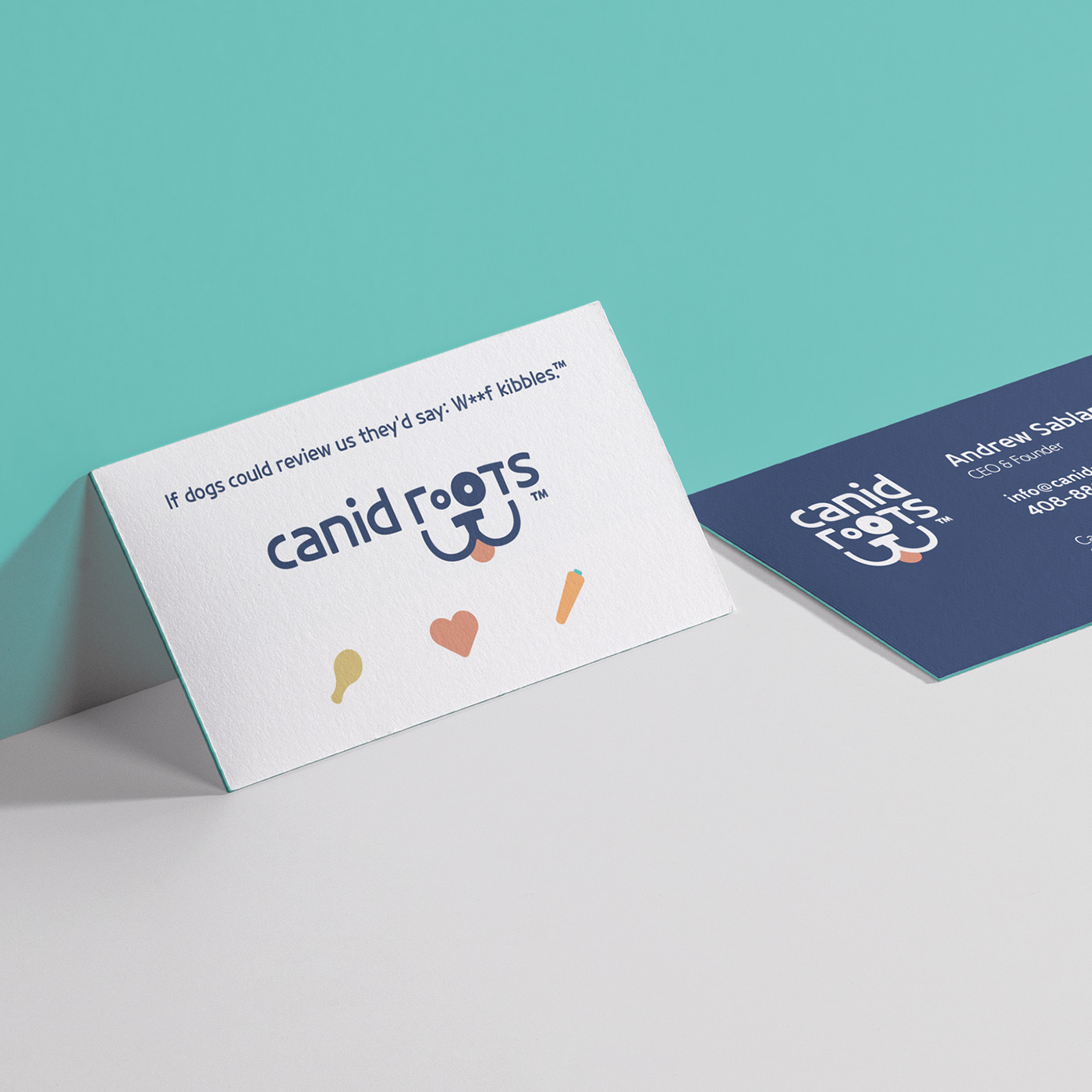 A mockup shows the business cards. Back is white with the Canid Roots logo. Back is blue with info.