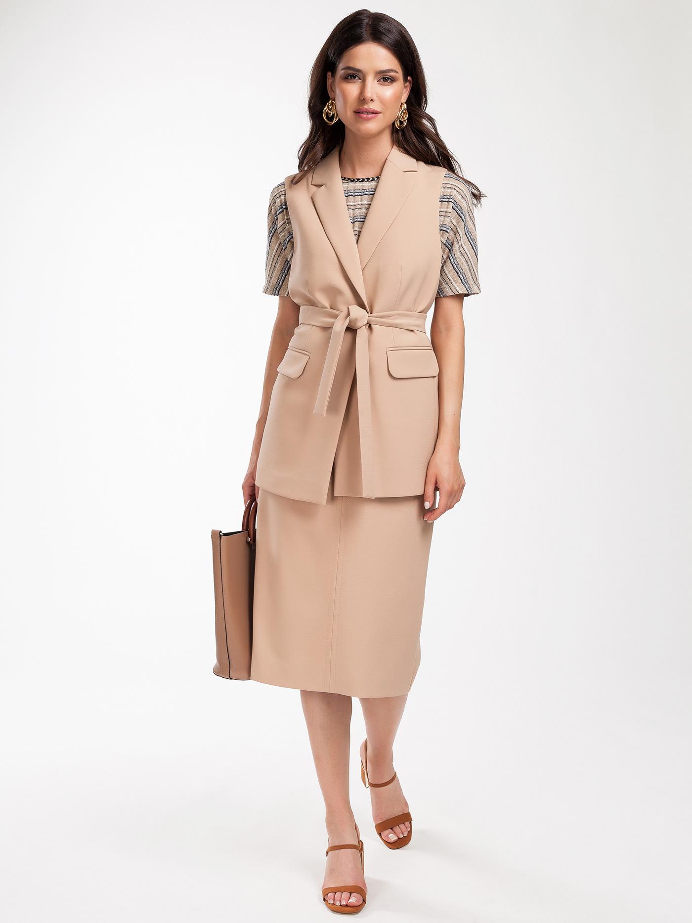 Image may contain: coat, clothing and handbag