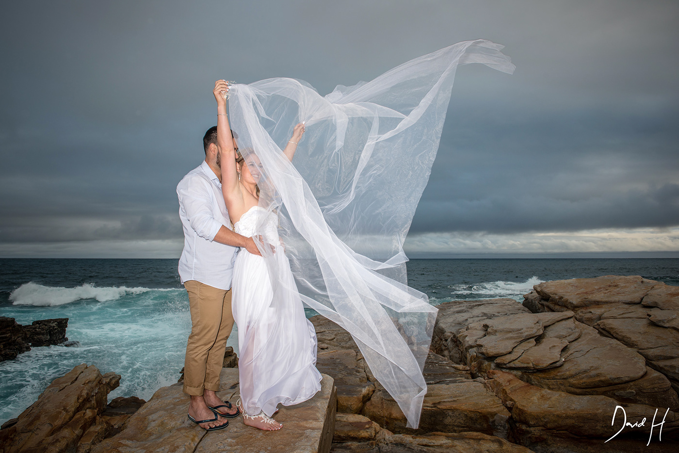 Image may contain: wedding dress, sky and bride