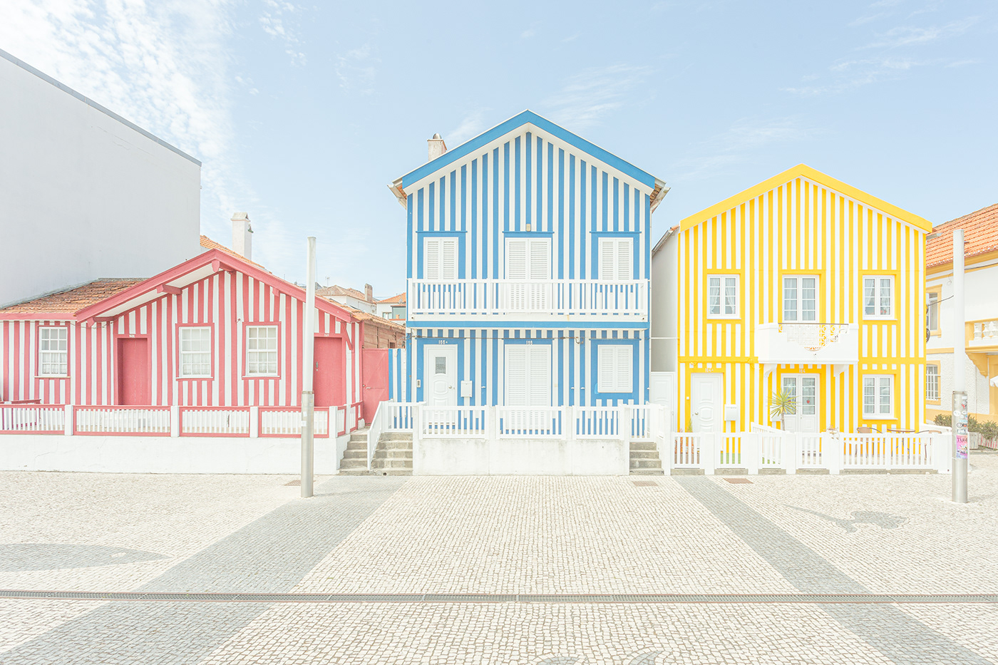 Three houses in Costa Nova with different colors of stripes.