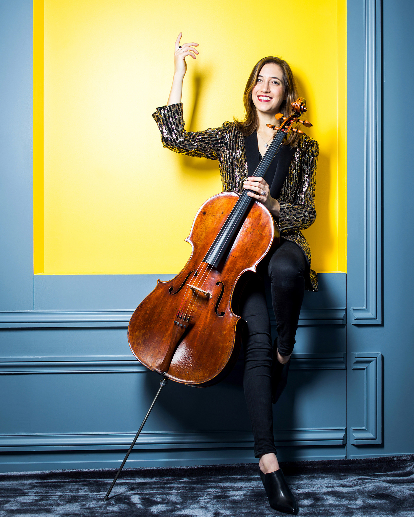 Image may contain: musical instrument, cello and wall