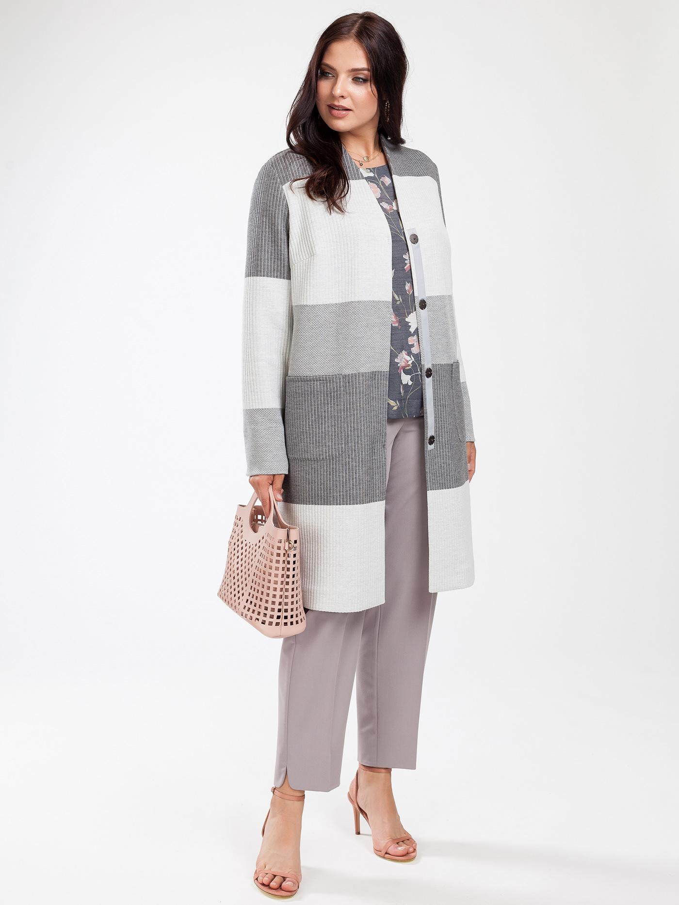 Image may contain: person, coat and handbag