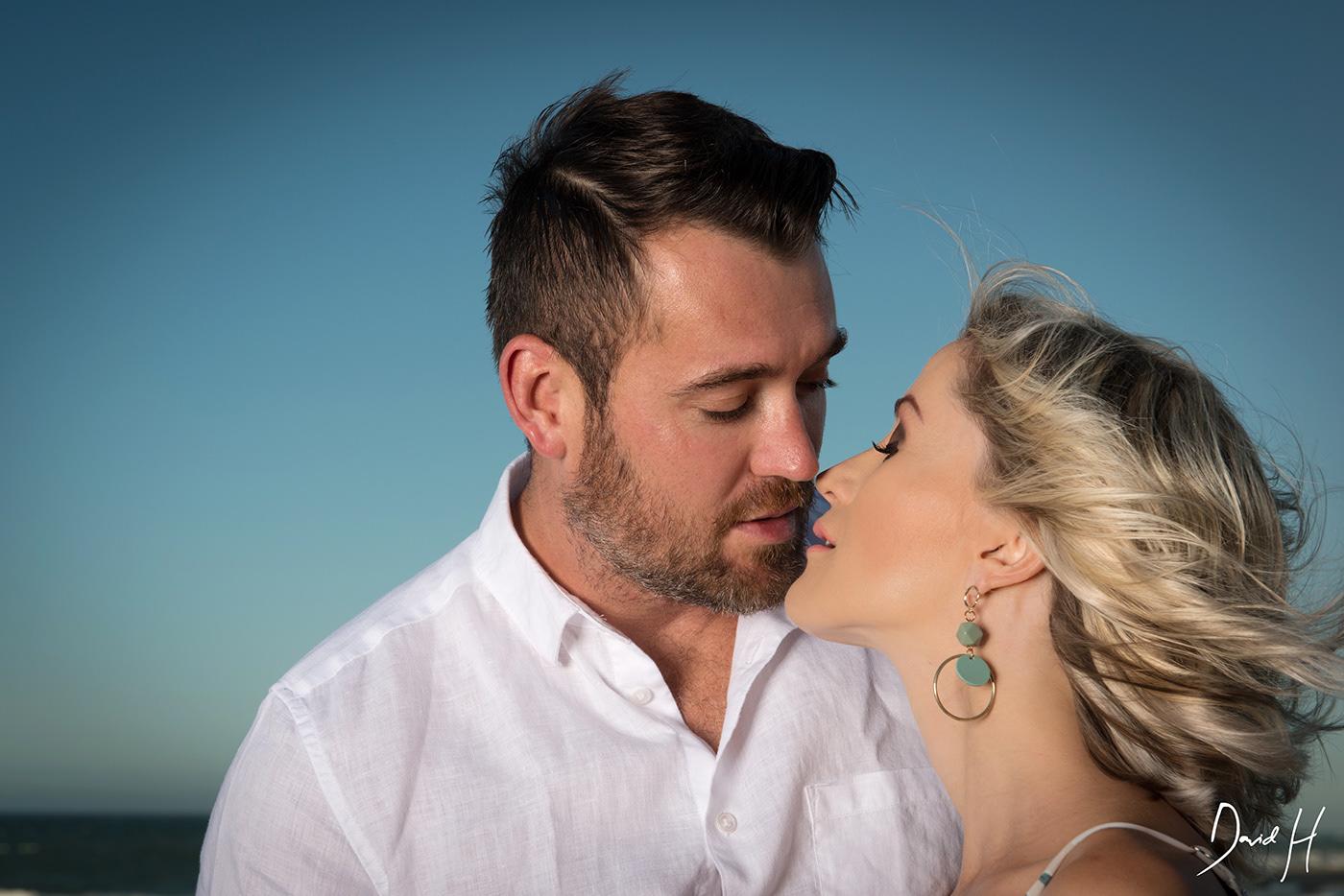 Image may contain: person, kiss and man