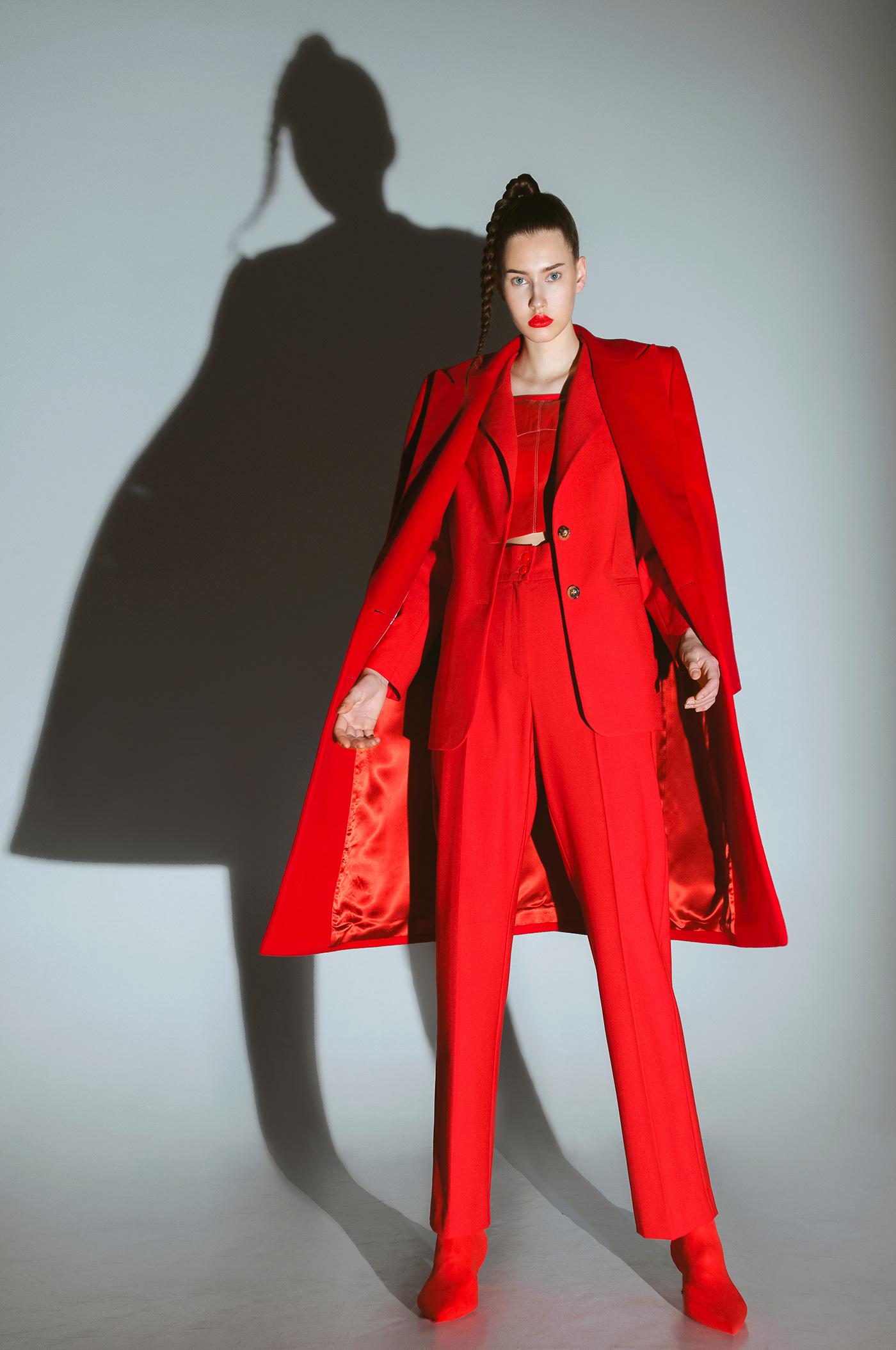 Image may contain: clothing, wall and coat