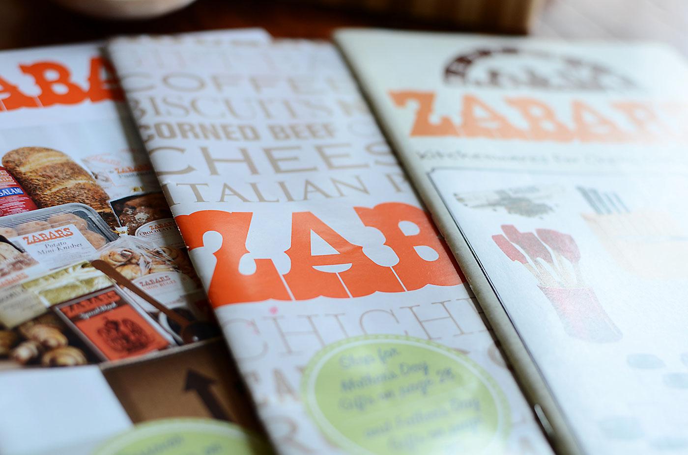 Close up of various Zabar's catalog cover designs