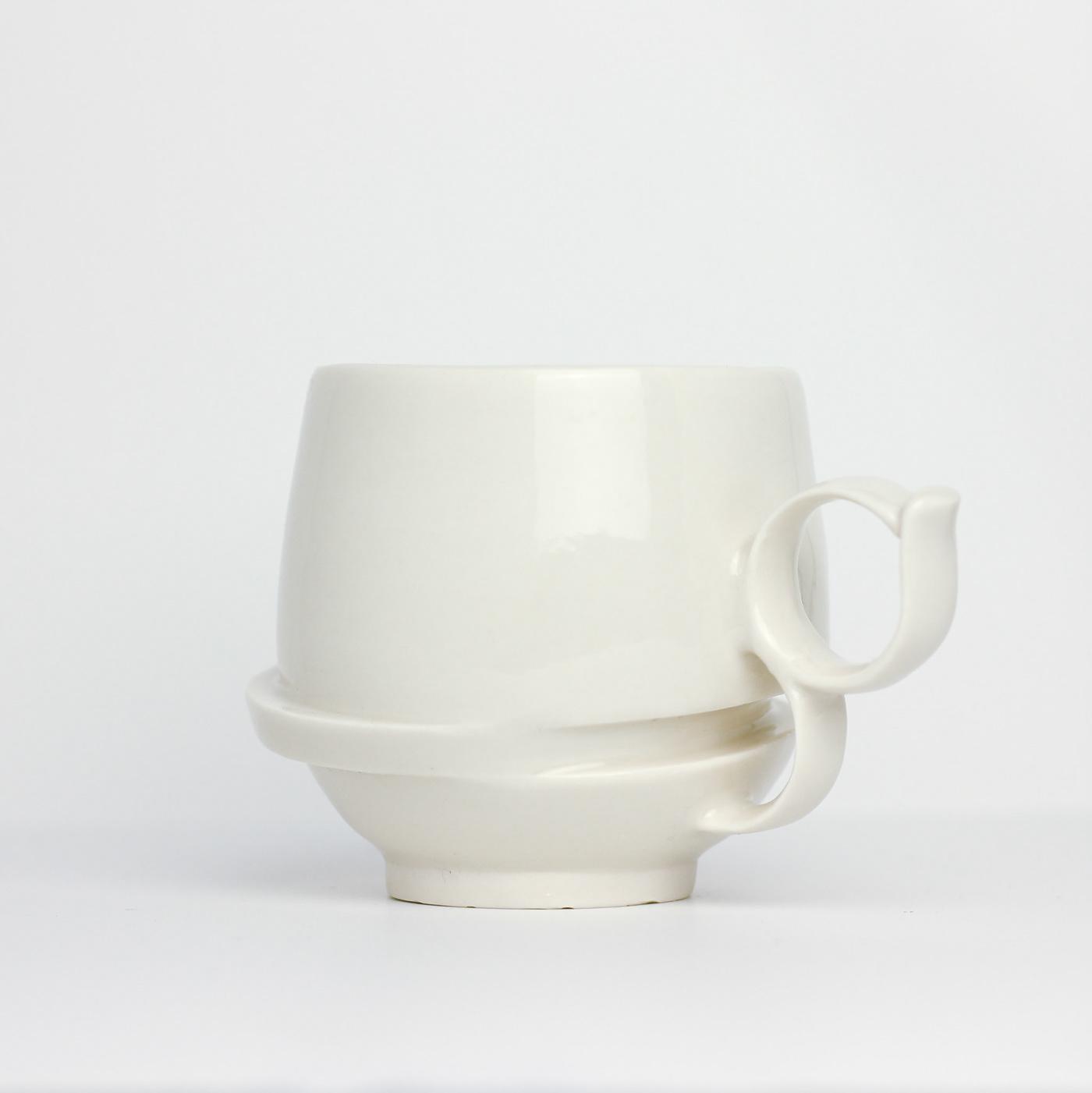 Image may contain: mug, wall and saucer