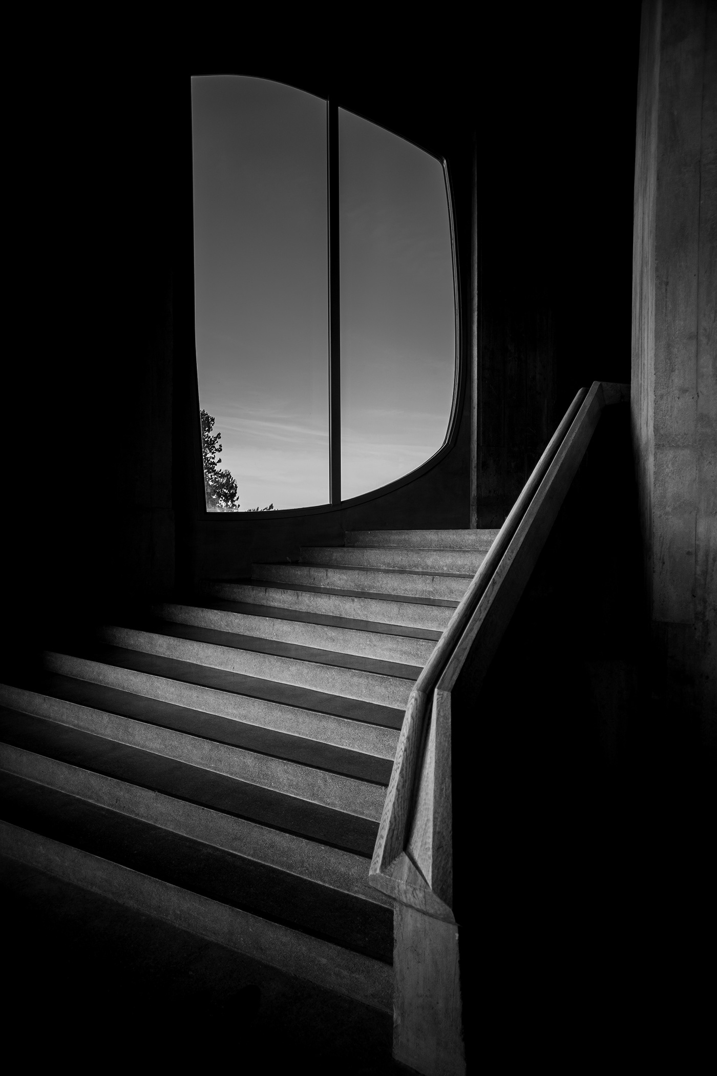 Image may contain: black and white, stairs and window
