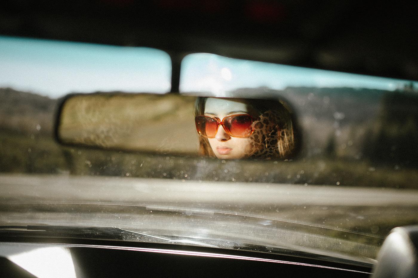 Image may contain: car, human face and sunglasses