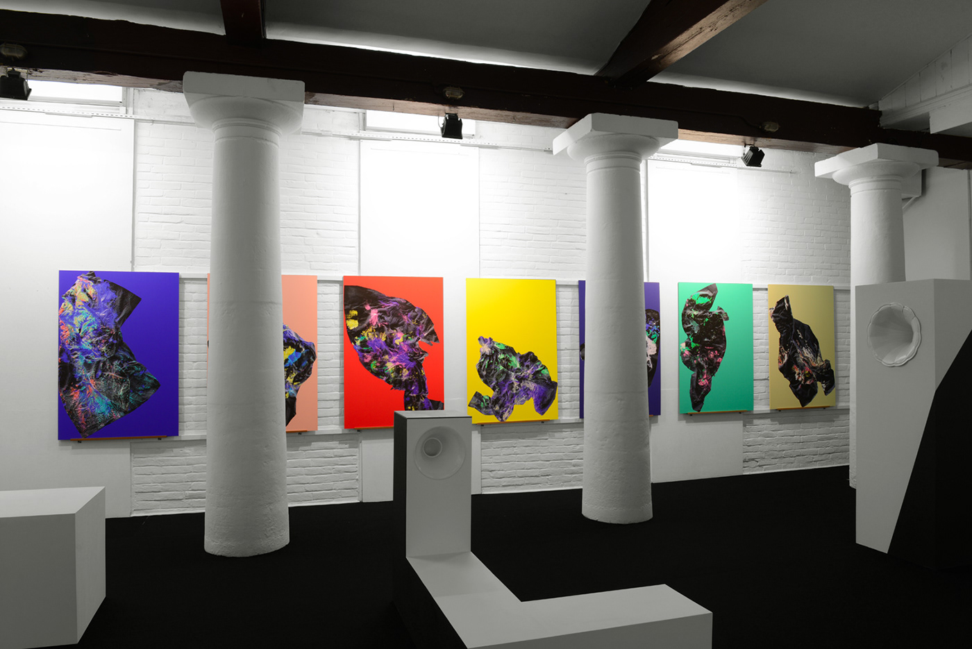 Installtion of seven digital paintings signed by two graphic designers