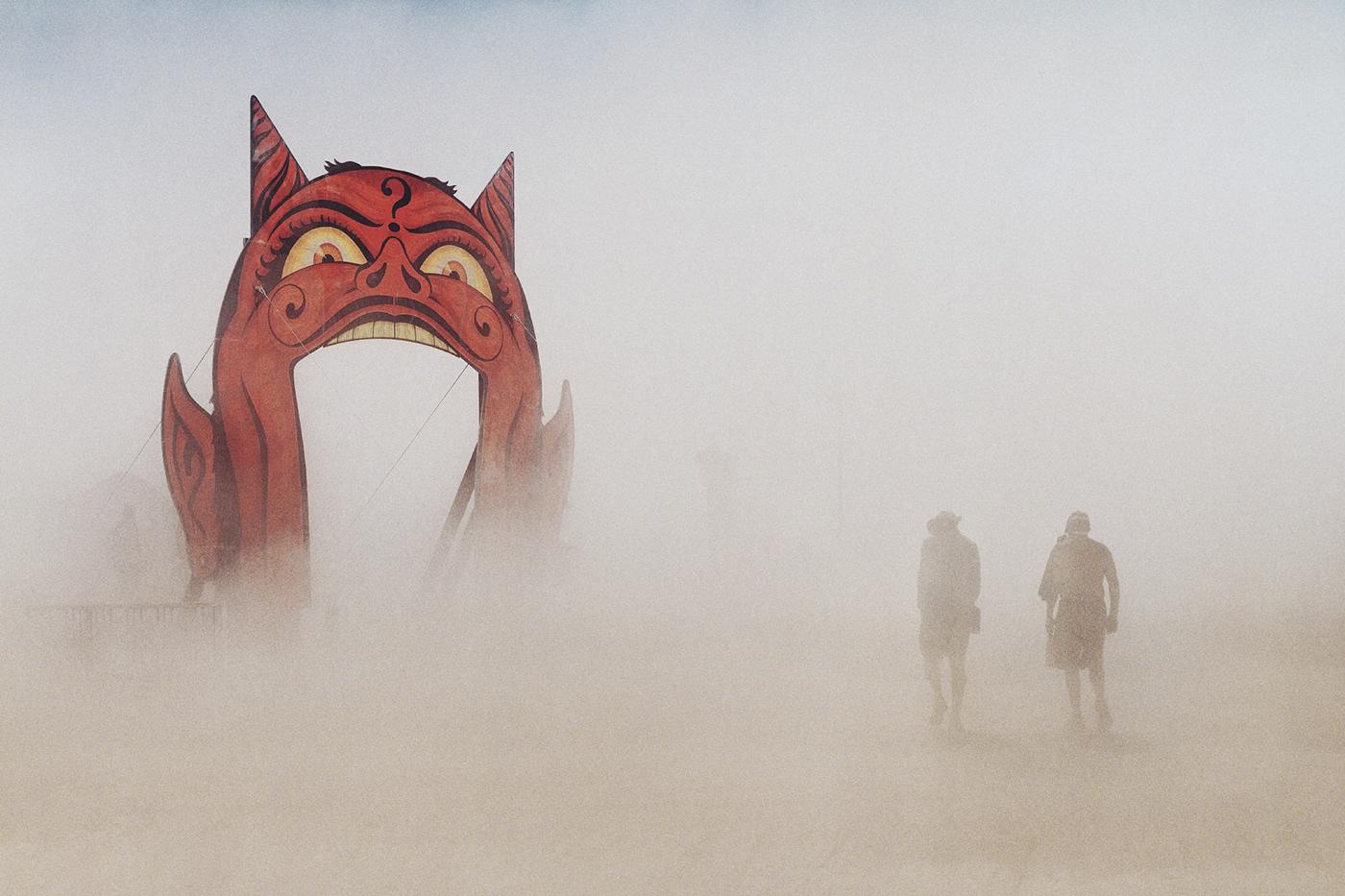 Burning Man photo sculpture art Exhibition  man fire outside