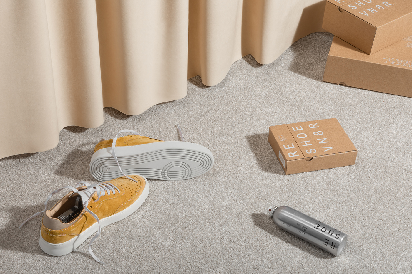 Reshoevn8r Shoe Cleaning Kit on carpet with yellow sneakers