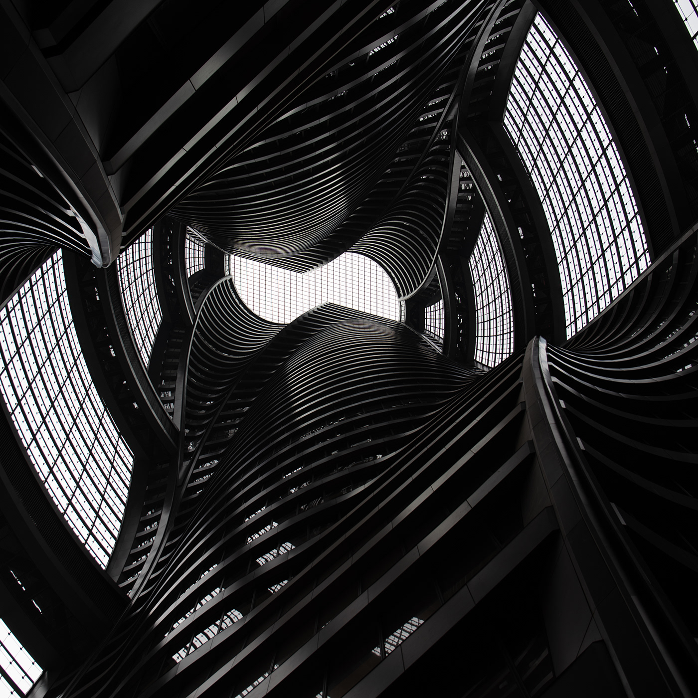 Image may contain: abstract, black and white and skyscraper
