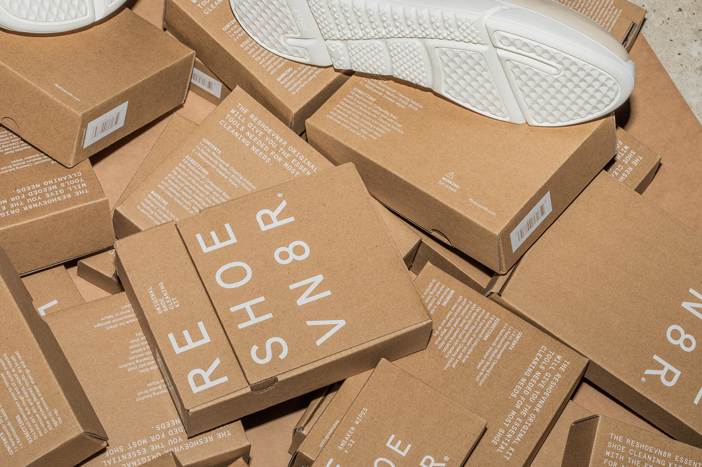 Reshoevn8r Shoe Cleaning Kits stacked up with white sneakers