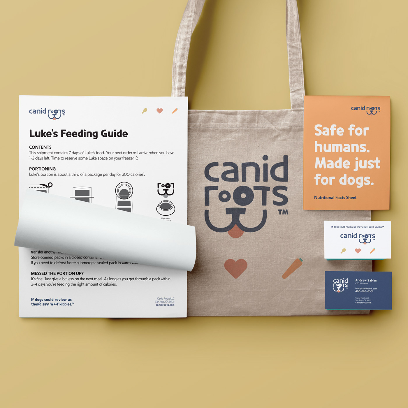 Mockup showing a letter size feeding guide for dogs, a tote bag with the logo on it and businesscard