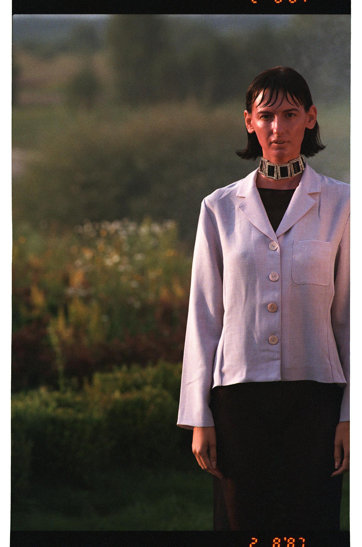 Image may contain: person, shirt and coat