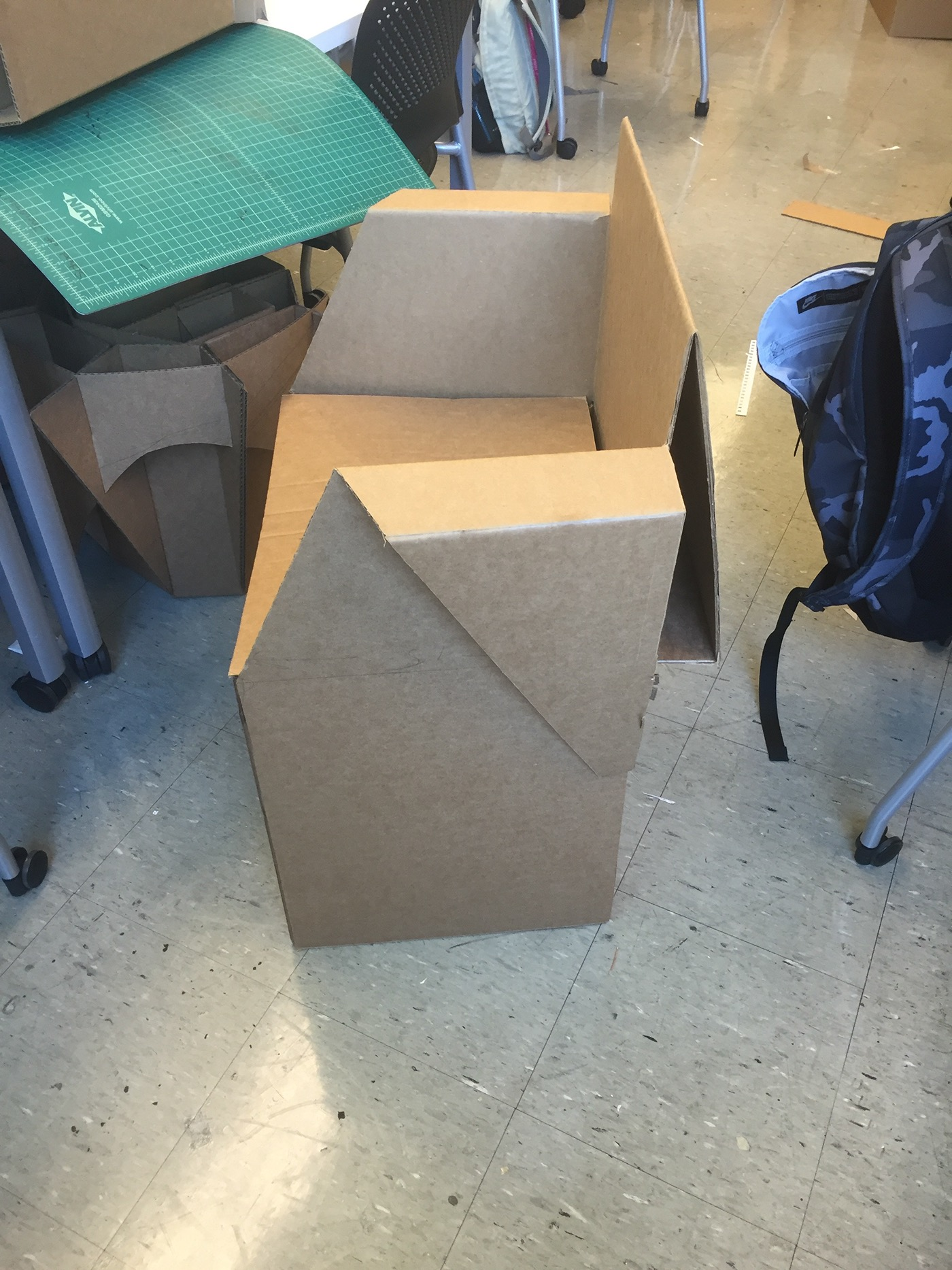 for the next iteration of chair i essentially peeled tall back and sides down to create armrests shape rest cardboard design with legs e64 legs
