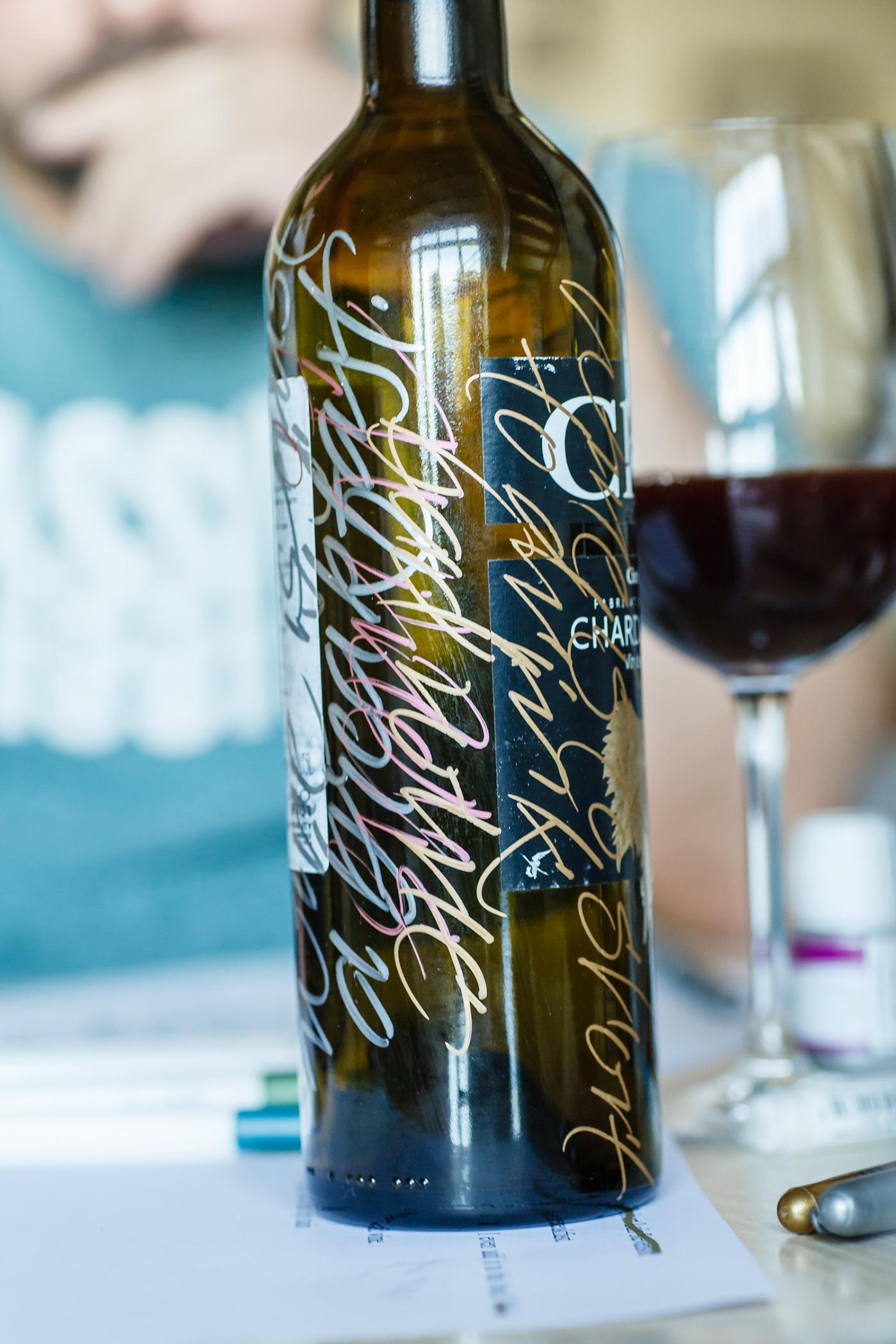 calligraphy creates elegant wine bottle packaging