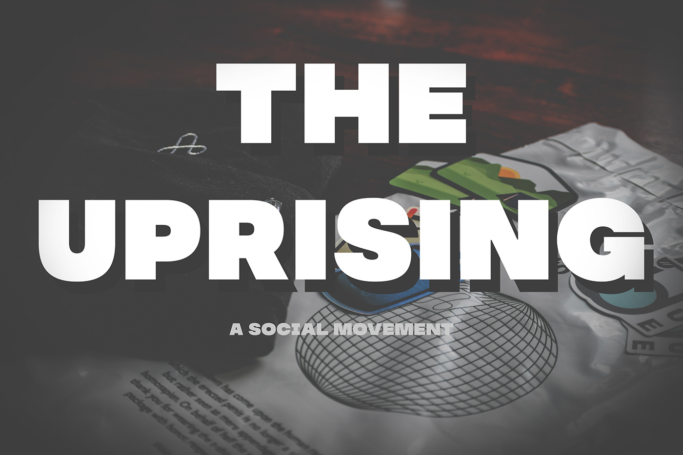 THE UPRISING, A SOCIAL MOVEMENT. Background features various items of The Uprising.