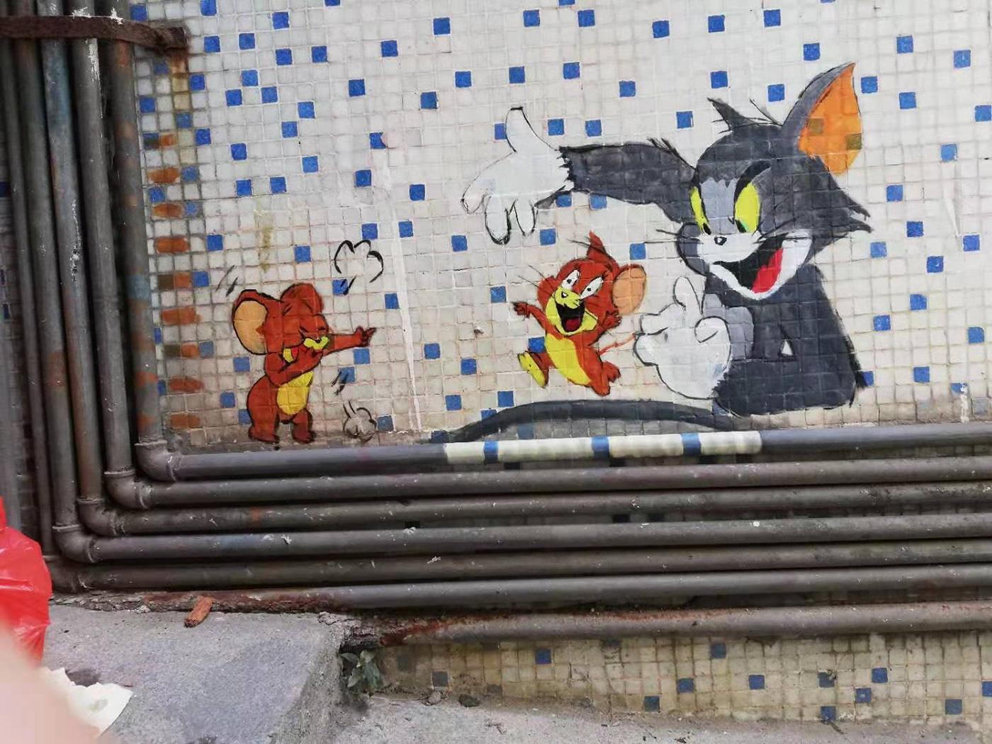 Image may contain: cartoon, graffiti and outdoor
