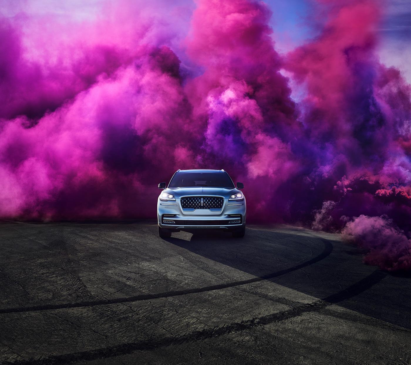 Image may contain: vehicle, smoke and car