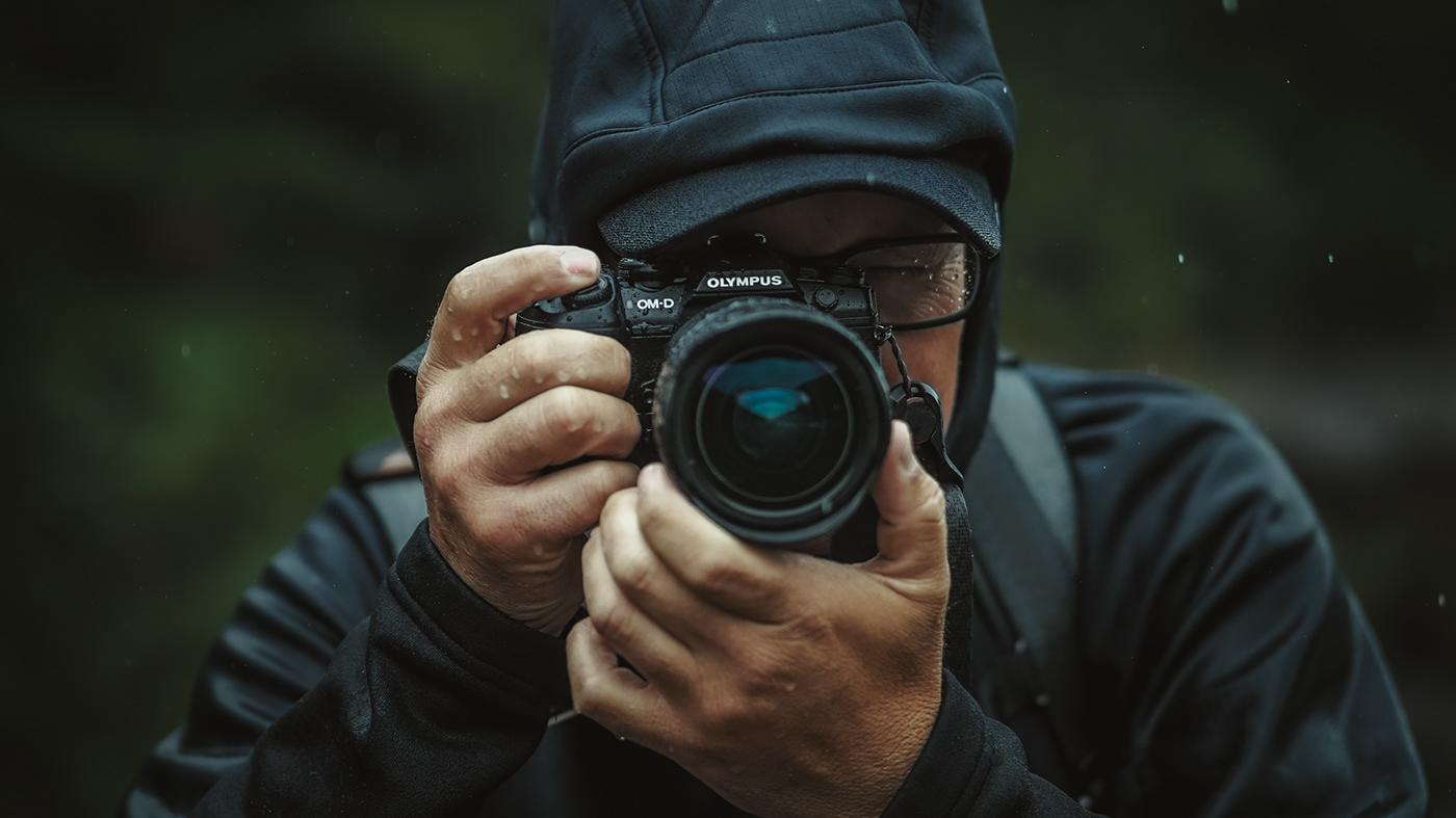 Image may contain: person, camera and man