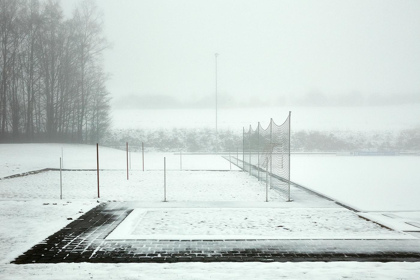 sports field sports ground Soccer Field winter snow Landscape fog misty atmospheric goal