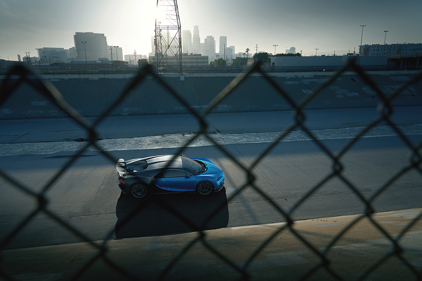 Image may contain: sky, fence and a bugatti chiron in the streets of los angeles