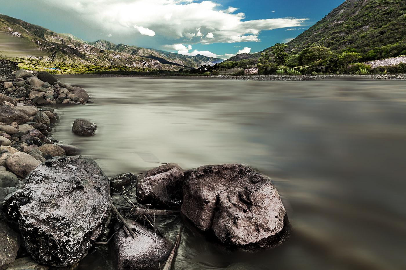 Image may contain: rock, lake and water