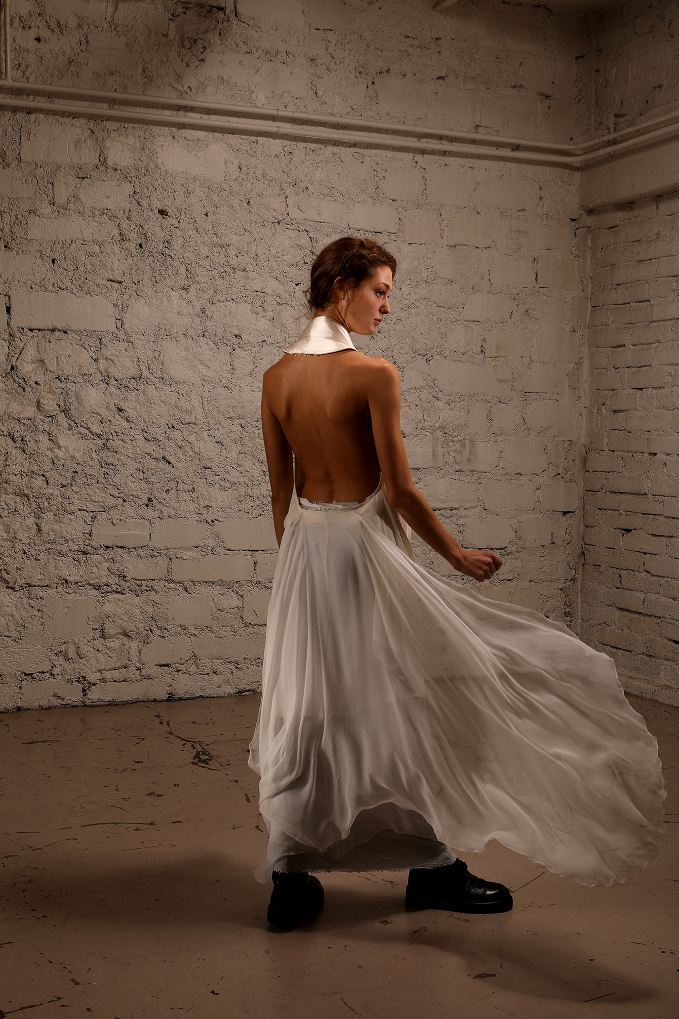 Image may contain: dress, wall and wedding dress