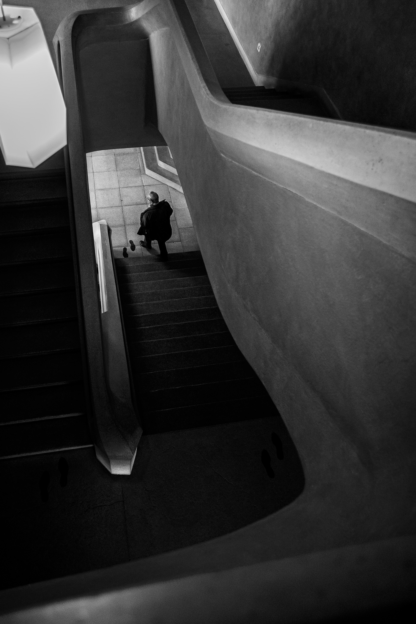 Image may contain: black and white, indoor and stairs