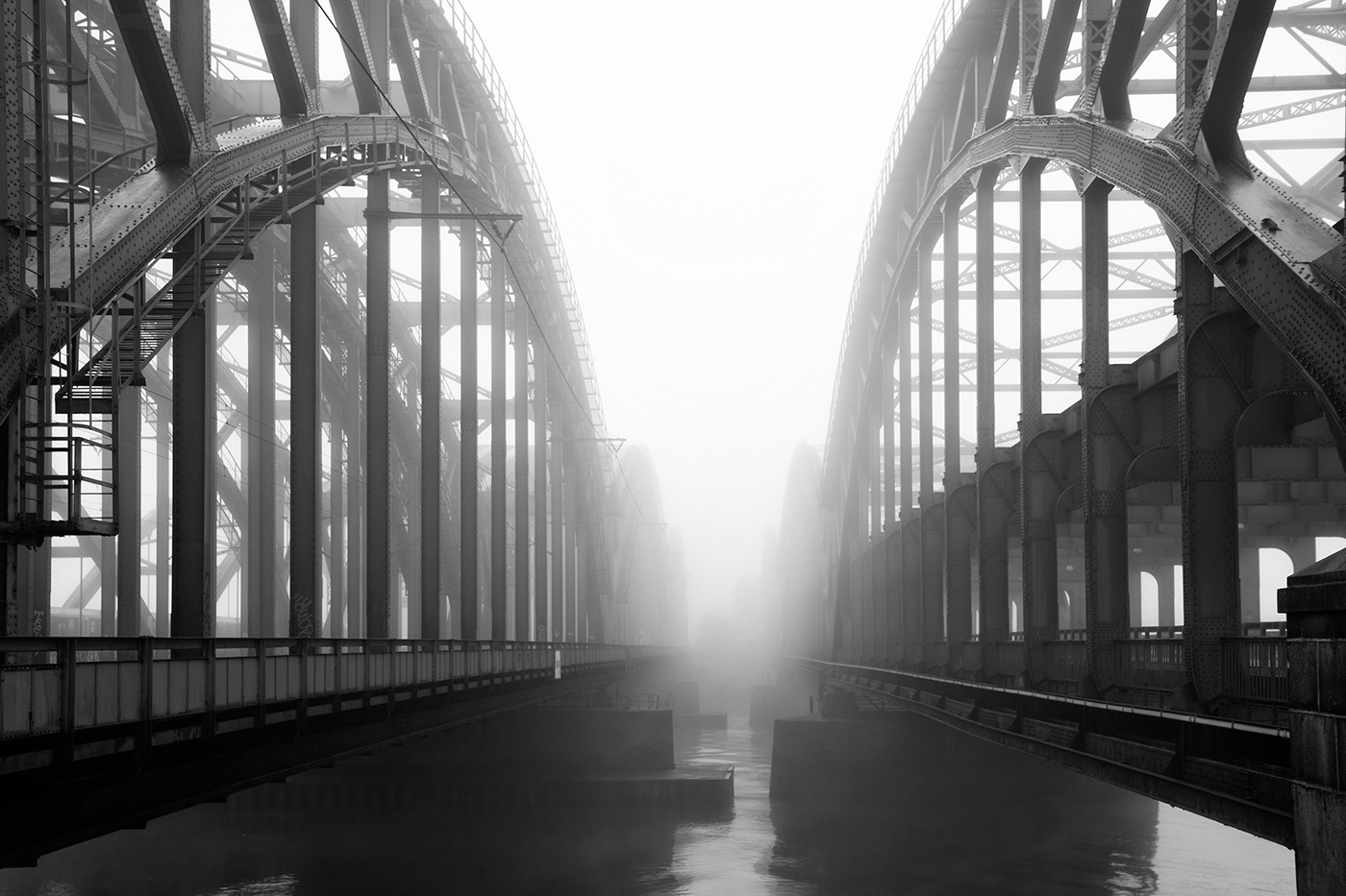 Image may contain: fog, bridge and black and white