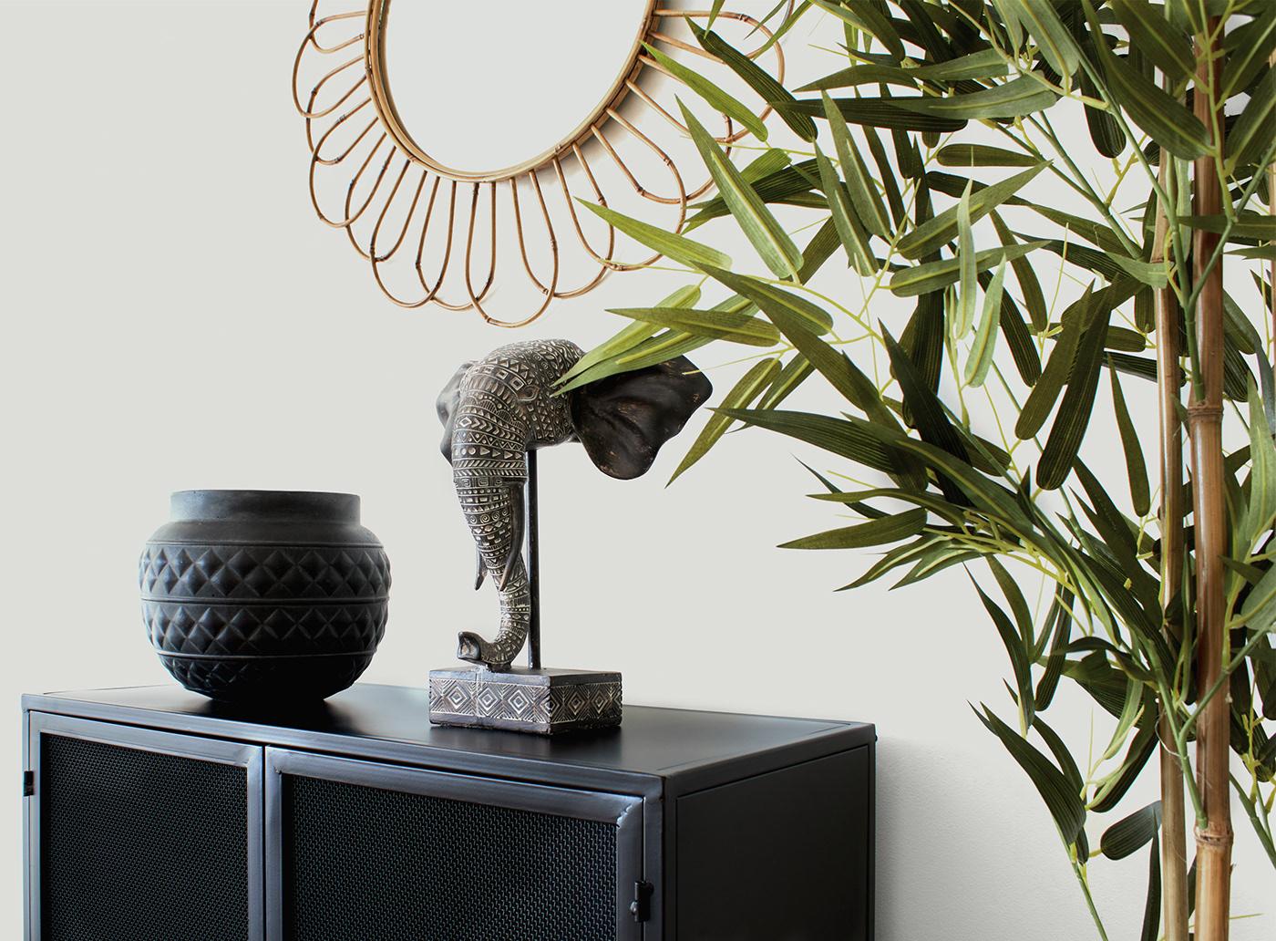 Image may contain: vase, wall and art